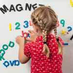Girl playing with Foam Fun letters and numbers
