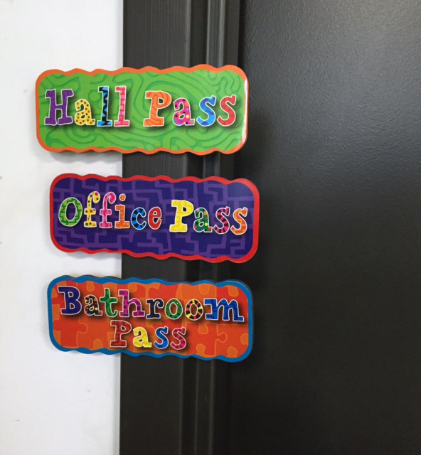 hall passes on door frame