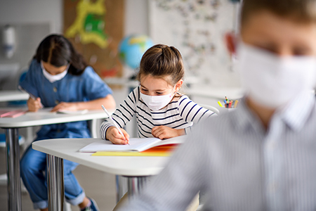 shutterstock_1751409812 students with masks small 72